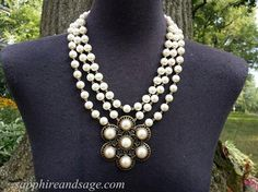 """""""The Tudors"""" Showtime TV Series Katherine Parr Pearl Strands Necklace www.sapphireandsage.com  A must-have for fans of Showtime's """"The Tudors"""" series!   This triple pearl strand necklace features a over-sized 10mm glass pearls, and a stunning floral center component.  Stunning and regal with any period ensemble, and modern enough to wear to your upcoming social gathering!"""