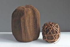 Kakishibu waxed cotton and linen, persimmon tannin, gessoed foam and cane by Nancy Moore Bess. Image via Browngrotta.