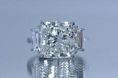 Absolutely stunning 7 carat Cushion Brilliant cut diamond set with two trapezoid shaped diamonds.