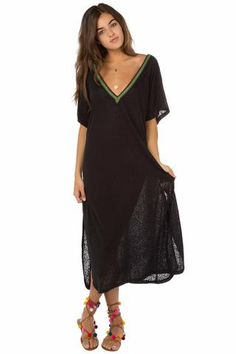 Find a happy medium with this mid-calf length. Soft, fun, lightweight dress with a deep V-opening on the back. Pair it with a bikini or for a night out. Made in Peru.