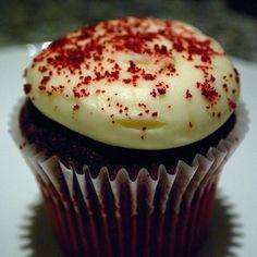 Red Velvet gourmet cupcake with red sprinkles