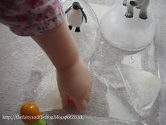 The fairy and the frog: Polar sensory tub with glitter!