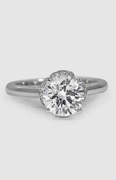 four curving petals sparkling with diamonds