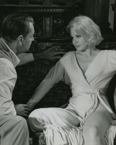 THE CARPETBAGGERS - Alan Ladd as fading cowboy star 'Nevada Smith' attempts to reason with Carroll Baker (who portrays alcoholic sexpot, 'Rena Marlowe' - Based on best-selling novel by Harold Robbins - Paramount Pictures - Photo Still.