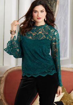 Polish up your look with this Victorian-inspired lace top, featuring a built-in knit camisole, bell sleeves and a romantic mock neckline. #catofashions