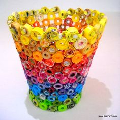 Upcycled Rainbow Vase Sculpture made from Magazines, Candy Wrappers, Catalogs & Coupon CircularsFrom MaryJeansThings