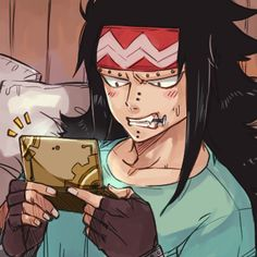 I didn't know Gajeel was into Videogames. It's cool that he's chewing on a nail too!
