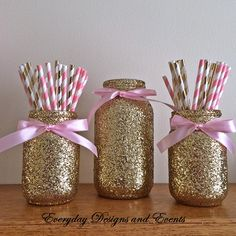This listing will provide you with a set of 3 glass glitter mason jars decorated with gold glitter and satin bows around the mouth of the jar, and a total of 50 paper straws (25 pink and white striped