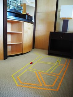 DIY Kids Hotel Activity Pack - Use the coloured paper tape (or masking tape) to make roads on the hotel room floor and drive your little cars around for some imaginary play.