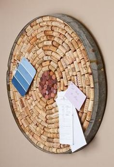 "Wine Cork Bulletin Board: Perfect for any wine lover, this unique bulletin board has been handcrafted from an authentic Napa Valley wine barrel and includes the metal barrel band. Approximately 23"" in diameter and filled with a variety of wine corks, it's a show-stopper."