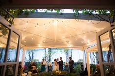 Intimate garden wedding at the O. Henry Hotel in Greensboro, NC. Gather Together Events + Design. Lighting by Total Production Services. Draping by Party Tables. Rentals from Party Reflections & ThemeWorks. Photography by Robin Lin.