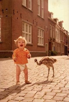 Just out walking my baby ostrich...in my shirt and my diaper...Seriously, aren't they both so CUTE!