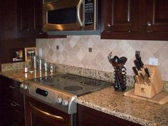Exotic granite countertop & large subway travertine backsplash tile. Description from hdwalls.xyz. I searched for this on bing.com/images