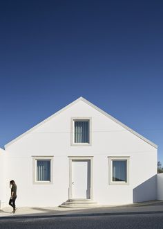 Completed in 2017 in Ansião, Portugal. Images by Hugo Santos Silva. Within the historic town centre of Ansião, an existing house of some historical value presents itself on the front of the development area. Our sight. Famous Architecture, Contemporary Architecture, Interior Architecture, Portugal, Modern Family, The Originals, Facade, Beach House, Minimalism