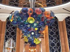 This Art Deco style chandelier in the Disney Magic Lobby Atrium was designed by Dale Chihuly and his studio. Unlike many of Chihuly's other works, this chandelier is not entirely glass. In order to meet the unique requirements of a cruise ship, the design team developed an entirely new medium, a combination of glass and acrylic, specifically for the Lobby Atrium chandelier.