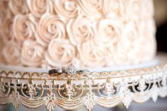 Wedding rings + wedding cake on vintage styled cake stand | itakeyou.co.uk