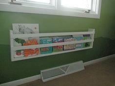 bookshelf under window at kids eyelevel