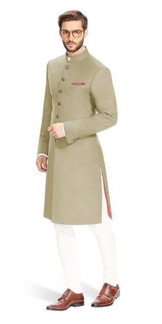 This Khaki Brown Achkan is distinguished by its cut and is designed to be comfortable and elegant. It is made with the finest Italian fabrics from Vitale Barberis Canonico. Indian Formal Wear, Mens Indian Wear, Mens Ethnic Wear, Indian Groom Wear, Indian Men Fashion, Mens Fashion Wear, Sherwani For Men Wedding, Wedding Dresses Men Indian, Mens Sherwani