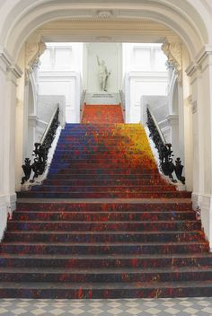 """Back in 2006, Warsaw's National Gallery of Art, Zachęta, held a group exhibition titled """"Polish Painting of the 21st Century."""" Painter Leon Tarasewicz contributed a site-specific work to the 60-artist exhibition, redoing the museum's Great Hall in a bath of red, yellow, blue, and green splatter pain"""