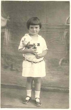 Sweet little Girl with her Doll: Photo from 1926