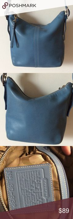 """Baby blue Coach shoulder/crossbody bag Very gently used, tiny signs of wear on bottom corners of the leather.   No stains or tears.  Inside has one zip and two pouches.   Silver hardware.  No hang tag or dust bag.  11"""" wide, 9 1/2"""" tall, 2"""" depth,  17""""-23"""" strap drop. Coach Bags Crossbody Bags"""