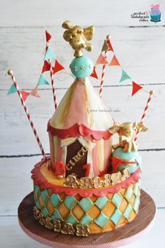 Girly vintage Circus cake, with elephant flirty cake toppers and a modern twist.