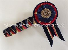 Midnight velvet & gold edged satin, red satin and gold lame sharkstooth show browband and pictured with standard swallowtail flags www.silverburnbrowbands.co.uk