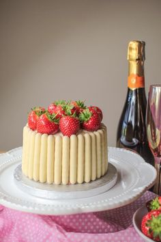 Impress your friends with this delicious white chocolate, strawberry and prosecco cake. It's a real show stopper!