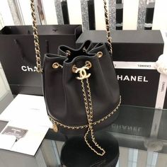 Chanel 2019 new woman drawstring bucket bag chain shoulder bags black MissRapunzel Fashion Trends Outfit Inspirationen Reise Tipps Luxury Purses, Luxury Bags, Luxury Handbags, Chanel Handbags, Purses And Handbags, New Chanel Bags, Celine Handbags, Fall Handbags, Chanel Chanel