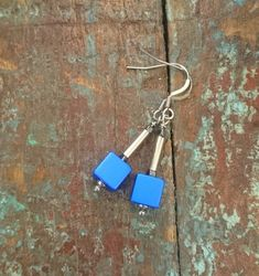 I am made in Sweden in the small city of Lund. Dangle earrings with earwire in stainless steel. Anodized aluminum cube with steel tube and hematite bead.Trendy, modern and comfortable. Total length is about and the cube is Personalized Items, Trending Outfits, Unique Jewelry, Handmade Gifts, Etsy, Image, Kid Craft Gifts, Craft Gifts, Costume Jewelry