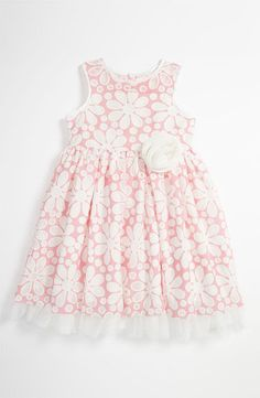 Pippa & Julie Daisy Dress: Pippa & Julie's Daisy dress ($48) comes in sizes for girls 4 to 6 years old. A tulle hemline and a rosette at the waist add to the sweetness of dress's laser-cut daisies lined with pink mesh.