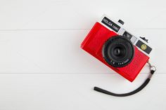 Cute red camera on white background by Tom Eversley on @creativemarket