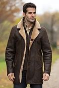 "Overland Outfitters Men's Daniel Shearling Sheepskin Coat   $1,795.00 | Style# 12506 |   The key to warmth is layering, and the rugged Daniel coat builds in layers of natural insulation, thanks to its textured Spanish shearling sheepskin construction. In addition, there's a removable half-vest shearling collar and bib. And to warm your hands, this button-front coat features leather-lined slashed pockets. Button up, and you're ready to face off with winter. 36"" long. Made in the USA."