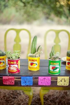 AHH! LOVE IT! We could use spanish cans of beans etc as vases! Put tissue paper flowers in addition to maybe cactuses. Plus check out the little tissue paper designs.