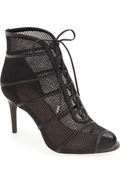 Sheer mesh and a sultry peep toe add a bit of edgy attitude to this lace-up bootie that's sure to turn heads.