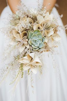 A unique, surprising wedding location that's totally picture-perfect // love the combo of origami and succulent