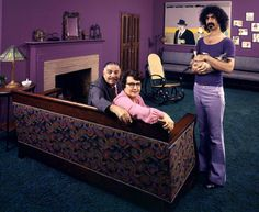 Frank Zappa in his Los Angeles home with his dad, Francis, his mom, Rosemarie, and his cat in 1970.