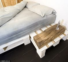 Pallet-able: This bed has been lovingly made using painted wooden crates. The couple call their technique 'upcycling' - taking quality, unwanted goods and making them like new