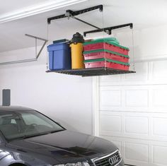 Racor Pro HeavyLift Cable-Lifted Storage Rack This ceiling-mounted garage elevator lets you load and lift storage items overhead, out of the Garage Ceiling Storage, Garage Storage Racks, Garage Storage Systems, Garage Organization, Organization Ideas, Canoe Storage, Bicycle Storage, Garage Shelf, Garage House