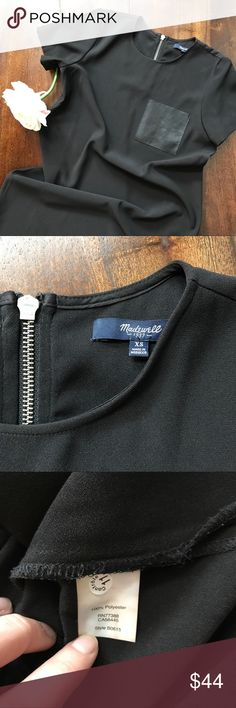 """Madewell • black pocket tee dress Madewell • black dress with a faux leather pocket • zipper on the upper black • looks adorable with a belt • small slits on the bottom sides of the dress • all measurements were taken flat and are approximate: pit to pit 18"""" 
