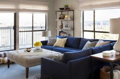Full of navy blue, neutrals and natural light, this bright apartment is comfortable and homey throughout. Designer Jennifer Jones created a design perfect for a family-friendly home, including using durable fabrics able to withstand active kids and their pets.