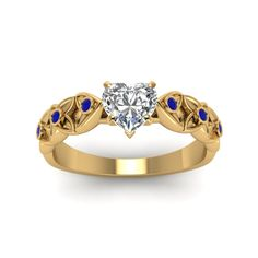 Gemstone Heart Shaped diamond Side Stone Engagement Rings with Blue Sapphire in 18K Yellow Gold exclusively styled by Fascinating Diamonds