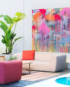 Modern and Colorful Splattered canvas of many colors Colored couch White modern couch with pleated diamond detail