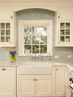 farmhouse sink, marble, window over sink. <3