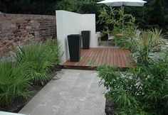 Contemporary Garden Lancashire  A predominately evergreen low maintainance scheme can still excite the eye. Here the minimalistic planting compliments the bold, clean lines of this contemporary garden, with dramatic sweeps of striking architectural foliage.