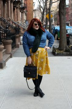 @nicolettemason looks gorgeous bringing in spring with a bright colored skirt & denim top.