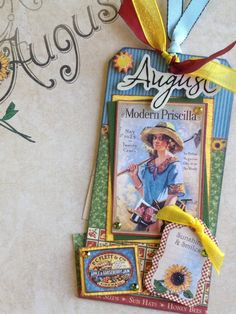 """August tag using Graphic 45 """"Place in Time"""" collection and Tim Holtz's Sizzix tag die."""