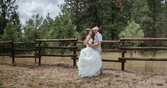 Matt Shumate Photography at the ridge at rivermere wedding venue bride and groom portrait first look next to fence and evergreen trees