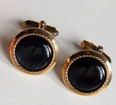 Vintage cufflinks Gold coloured metal with black centres and patterning round the rim These are vintage cufflinks probably made in the 1960s or 1970s
