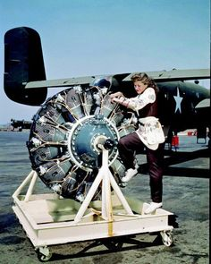The radial engines have cooling fins like the small engine on a rotary lawn mower or gasoline-powered chain saw. The broad diameter is necessary for cooling but increases drag. Pictured behind a B-25 Mitchell, at North American's Los Angeles plant.